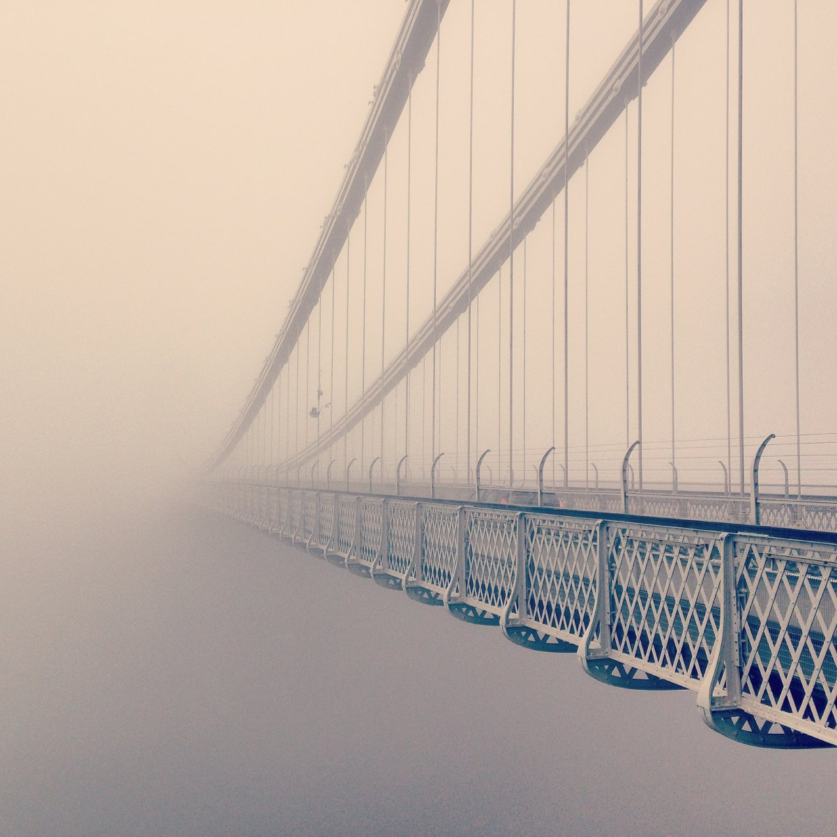 a-bridge-disappears-into-the-fog-in-this-photo-by-helen-whelton-of-the-uk