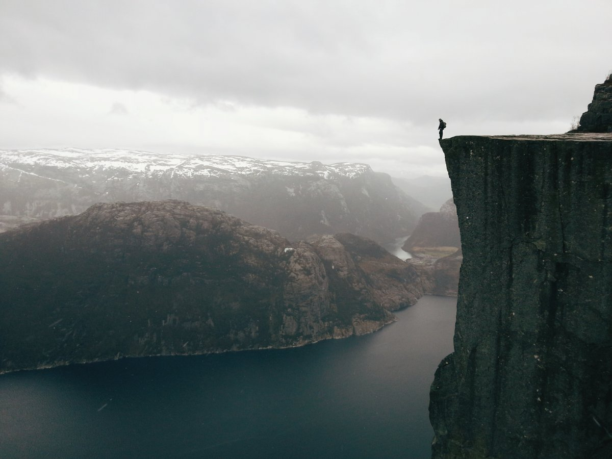 and-a-man-stands-dangerously-close-to-the-edge-in-this-photo-by-atle-rnningen-of-norway