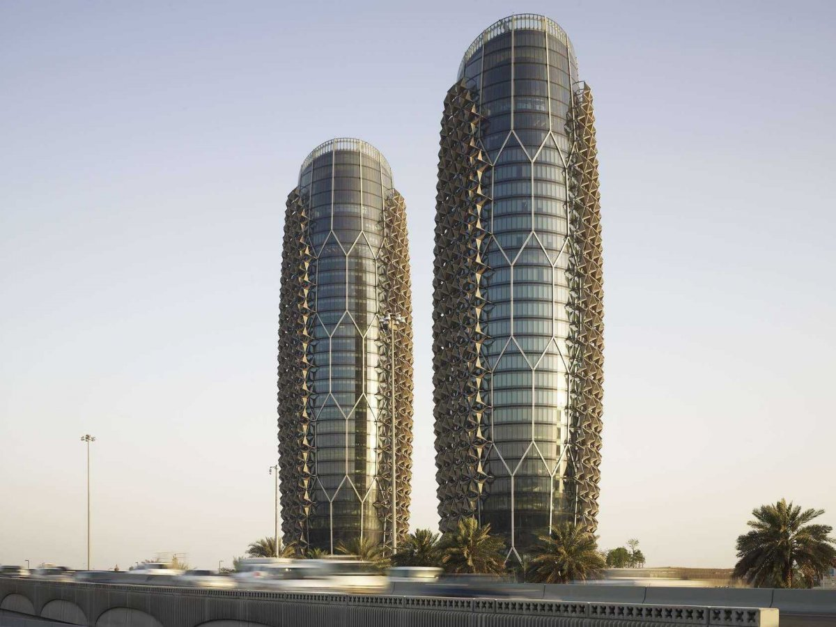 the-al-bahr-towers-in-abu-dhabi-uae-stand-25-stories-tall-the-lattice-design-references-mashrabiya-traditional-screens-used-to-gain-privacy-and-shade