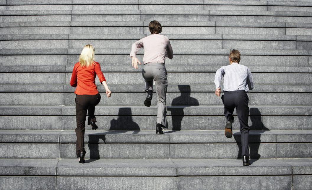 Businesspeople Running Upstairs