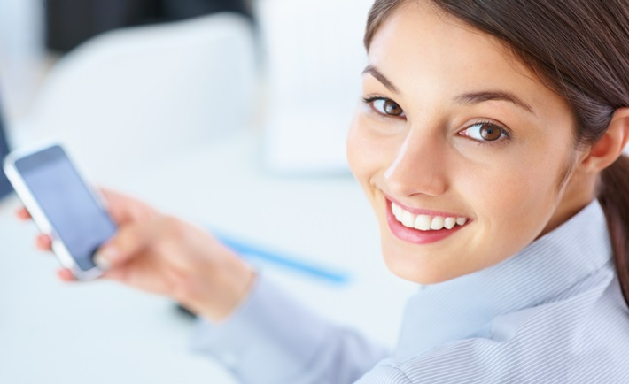 Cute female executive using mobile phone
