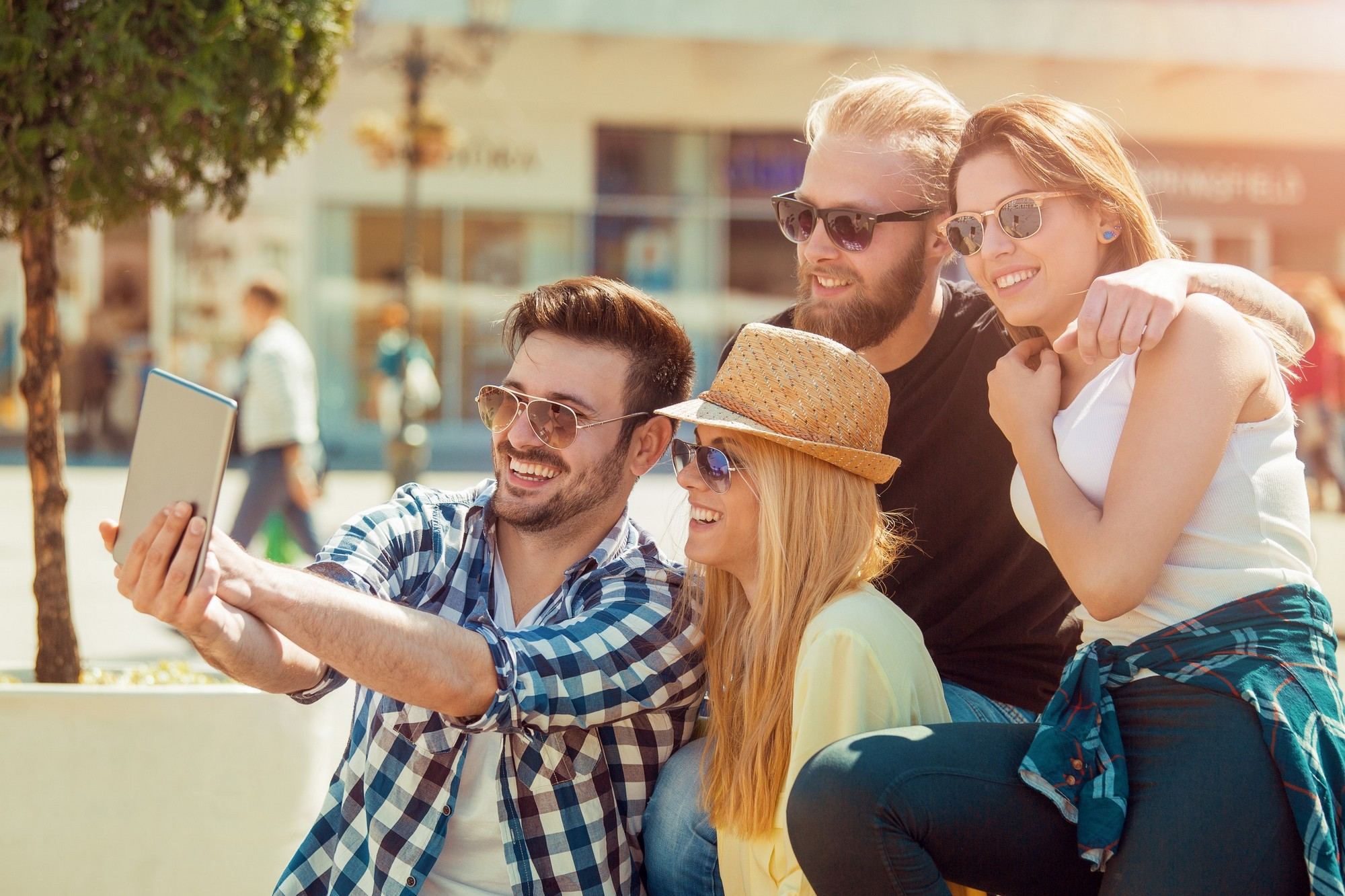 Group of friends taking a selfie with smartphone.