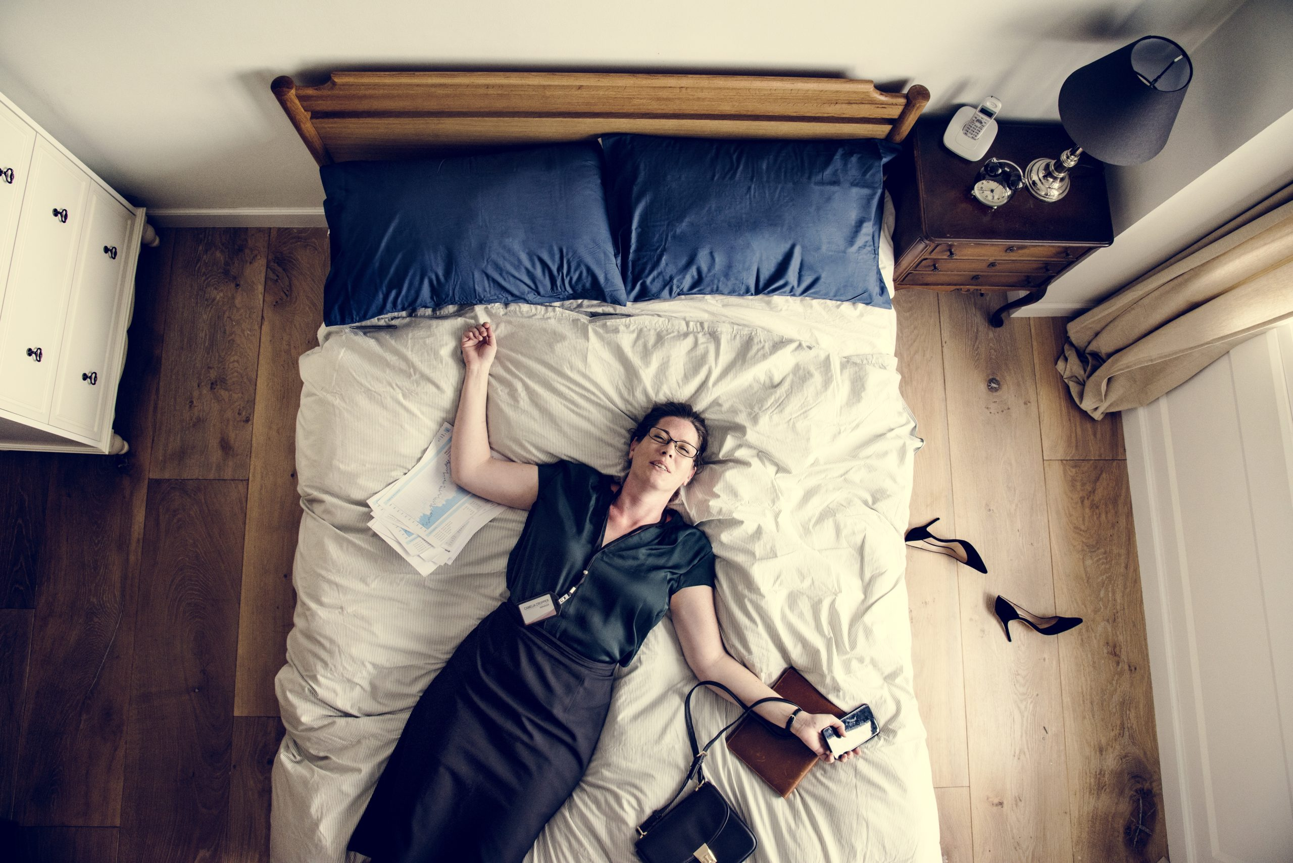 Exhausted business woman falling asleep as soon as she came back home